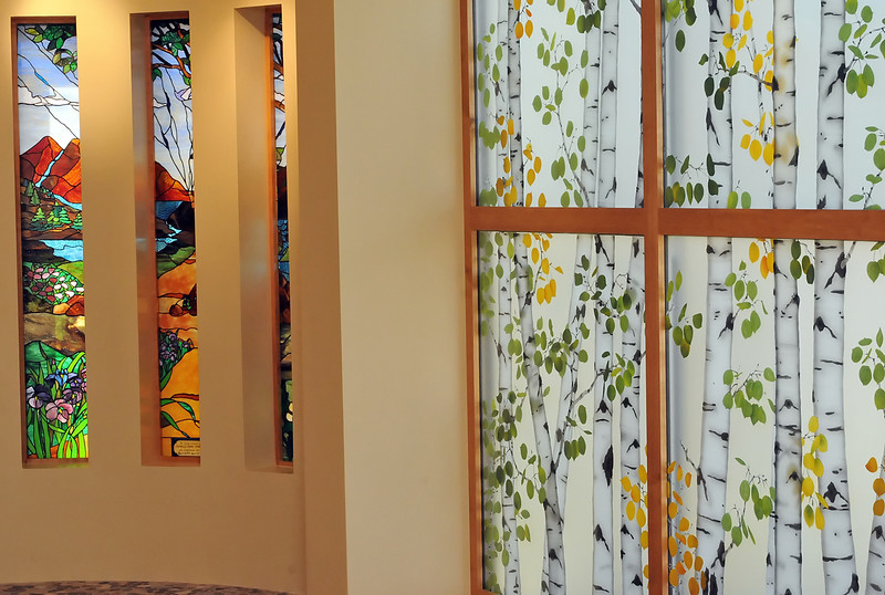 The new chapel at McKee Medical center features stained glass and an entire wall with glass panels depicting a grove of aspen trees.