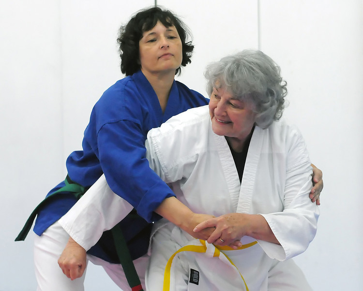 Eileen Van Baren, right, and classmate Andrea Young practice together during an American Kenpo karate class Thursday at International Black Belt Academy, 304 E. 5th St. in downtown Loveland.