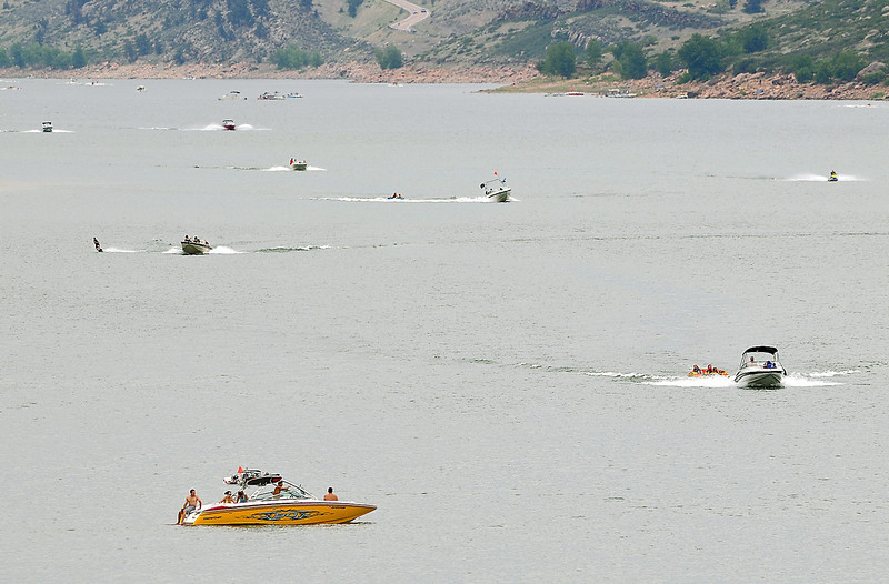 Boaters beat the heat Sunday at Horsetooth Reservoir. Sunday's highs reached into the high 90s but a relatively cooler week is in store starting today with highs in the upper 80s and a chance for afternoon thunderstorms.