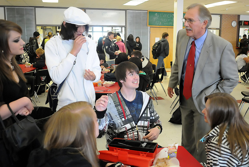 Loveland High School principal Fred Dreier, right, chats with students during their lunch break Wednesday in the school's cafeteria. Seated at front from left are Cynthia Smith and Carissa O'Connor and at rear from left are Ashe Marbury, Brian Prout and Edward Van Norman. Dreier is retiring after 40 years as an educator including 23 years as a social sciences teacher.
