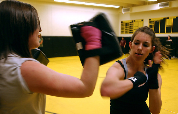Sarah Van Horn throws an elbow in Kaley Germer's direction, Wednsday, Apr 15, during Thompson Valley High's Self Defense class.