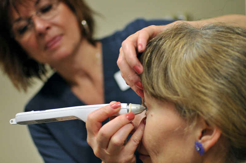 Brenda Haas gets her eyes checked for glaucoma by Peeny Smart during Saturday's Health Fair at McKee Conference and Wellness Center.  Anesthetic eyes drops are administered before the pen tool is tapped on the eye ball, measuring the pressure of it.  The higher the pressure, the greater the possibility of damage to the ocular nerve.  Haas passed the test.