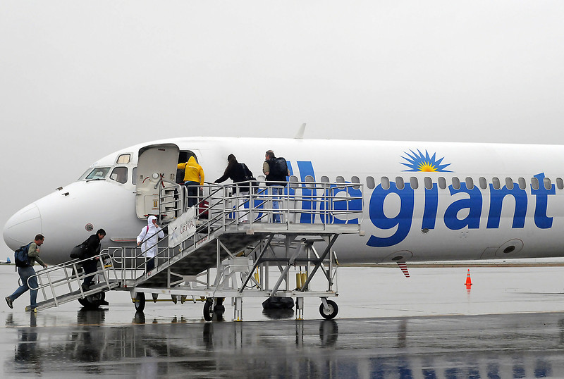 Passengers board an Allegiant Airlines jet headed to Las Vegas on Friday morning at the Fort Collins/Loveland Airport.