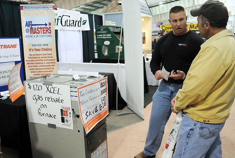 Air Masters HVAC salesman Aaron Wahlert, left, chats at his booth with Loveland resident Tom Huerter during the Northern Colorado Spring Home & Garden Show on Friday at The Ranch. The show continues in the Ranch-Way Feeds West Pavilion today from 10 a.m. to 5 p.m. and Sunday from 11 a.m. to 5 p.m.