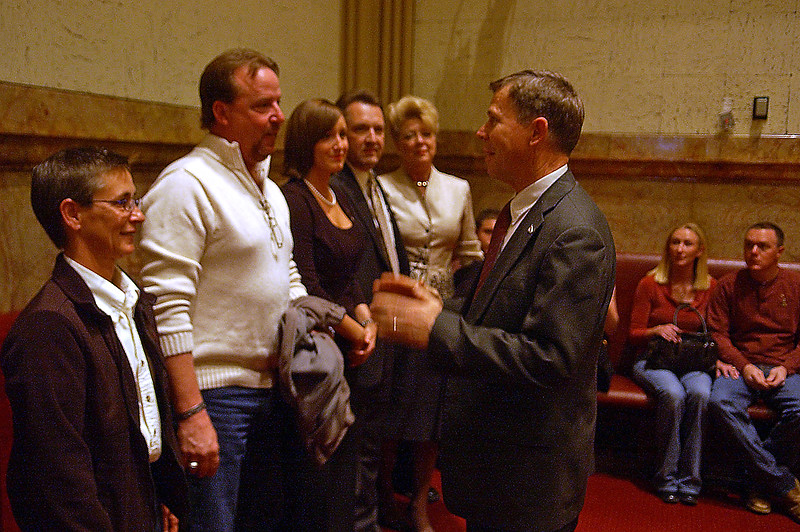 Sen Kevin Lundberg, greets family and friends of the late Justin Bauer, Friday, in Senate Chambers. Lundberg queried the Senate to approve a Resolution designating a segment of State Highway 56 be memorialized for the fallen soldier.  From left to right, Jackie Murphy, aunt, Greg Bauer, father, Kair Bauer, wife,  Kent Campbell, father-in-law, Trisha Campbell, mother-in-law, and friends April and Jeremy Beumer.