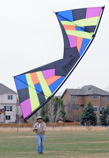 Fort Collins resident John Farrell flies a 4-line Revolution Zen kite Tuesday afternoon at Fossil Creek Park. Farrell will demonstrate kite ballet to music during Kites in the Park on Sunday at Spring Canyon Community Park in Fort Collins. The event is free and runs from 10 a.m. to 4 p.m.