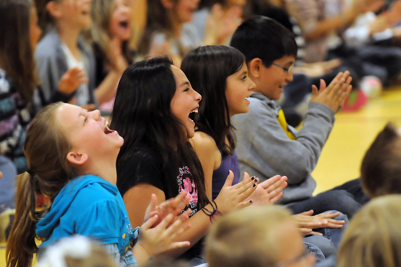 Sarah Milner Elementary School students laugh as they play a clapping game in the gymnasium during a multi-cultural assembly featuring African drumming and dancing instructors Maputo Mensah and Mawuenyega Mensah. From left are fourth graders Megan Hurr, 10, Melanie Ramos, 9, Oceana Gray, 10, and Omar Quintana, 10.