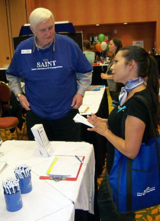 Loveland resident Lenina Olivas, right, asks Gary Thomas, executive director of SAINT, a few questions about volunteer opportunities with Senior Alternatives In Transportation during the Get Involved Community Volunteer Fair on Saturday.