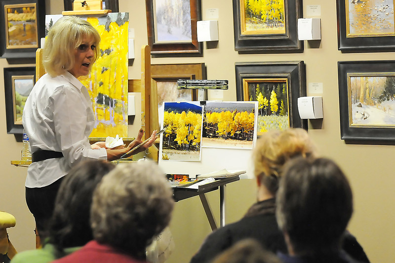 Boulder-based artist Sallie K. Smith, back, gives an oil painting demonstration Saturday at the Loveland Museum/Gallery as part of the Colorado Governor's Invitational Art Show and Sale.