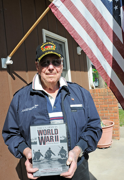 World War II veteran Bob Anderson poses Friday outside of his Loveland home.