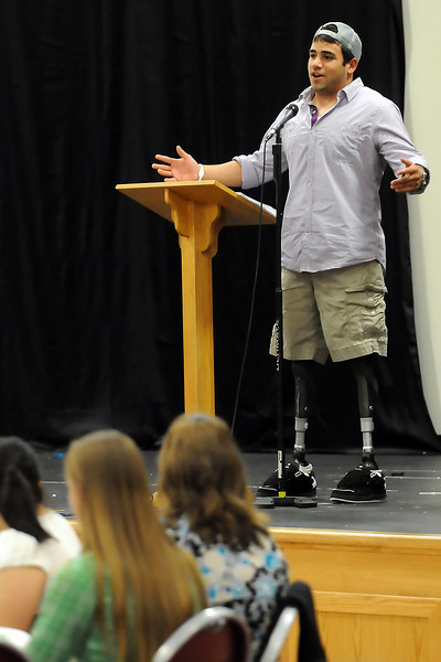 Guest speaker Nikko Landeros gives a speech during the Heroes Among Us event Wednesday evening at Immanuel Lutheran Church.