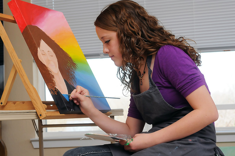Bill Reed Middle School eighth grader Cosette Klingler, 14, works on a acrylic painting last Friday in her Loveland home in preparation for the Art for a Child's Sake art show.