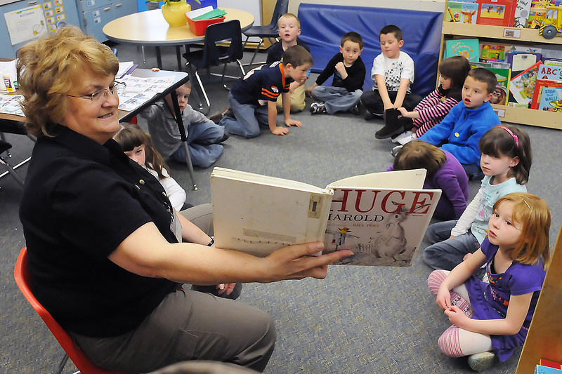 Berthoud Elementary School kindergarten teacher Millie McCloy reads a book to her students Tuesday afternoon in their classroom.