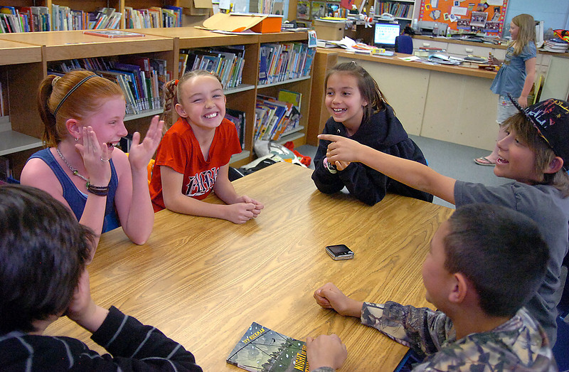 Truscott Elementary School students share a laugh while practicing for Battle of the Books Friday at their school. Clockwise from left they are Dustin Atkinson, 10, Izze Johnson, 11, Remi Clarke, 10, Brittany Martinko, 10, Connor Lewchuk,11 and J.J. Cowley, 10.