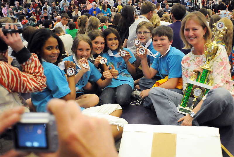 Members of Centenniel Elementary School's Odyssey of the Mind team pose for pictures Saturday at Mountain View High School after picking up their medals and trophy for placing third in Division I for the Problem 5 called Full Circle. From left holding medals are fifth graders Sierrah Huntington, 11, Lacy Sauer, 11, Olivia Babcock, 11, Victoria Sofias, 10, Ryan Filler, 11, and Vaughn Parsons, 11, and holding the team's trophy is coach Susie Babcock.