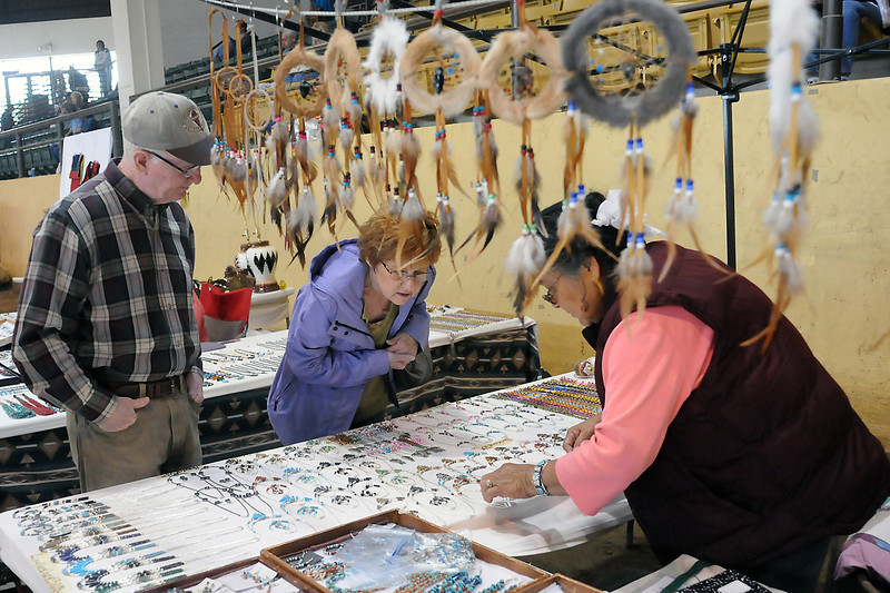 Mark Pemberton, left, and Dee Pemberton of Omaha, Neb. look at Navajo jewelry on display at Page, Arizona resident Alice Hudson's booth on Sunday during the Spring Contest Powwow and Indian Art Market at the B.W. Pickett Equine Center in Fort Collins.