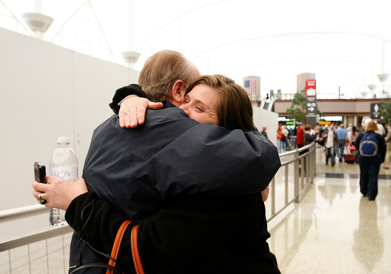 Loveland resident Jon Chevalier, hugs his daughter that he met for the first time on Tuesday, April 12 at Denver International Airport. (Photo by Gabriel Christus)