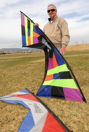 Fort Collins resident John Farrell poses with several of his kites April 12, 2011.