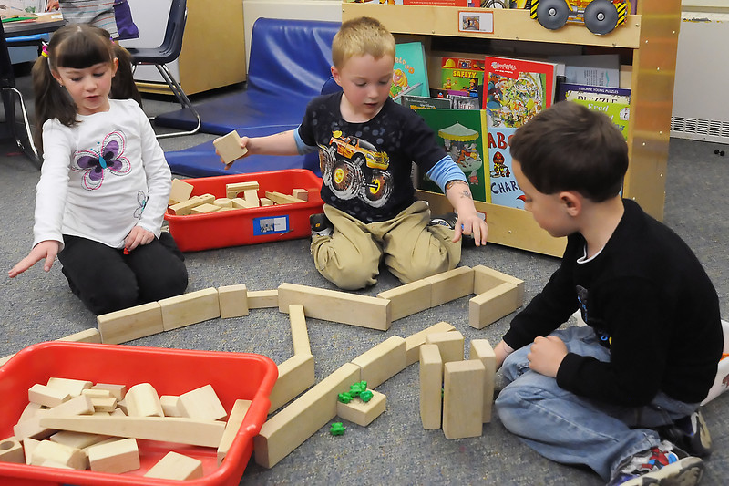 Berthoud Elementary School kindergartners build a castle out of wood blocks Tuesday afternoon after lunch. From left are Abby Wiggins, 6, Joshua Biddulph, 5, and Hunter Androvich, 6.