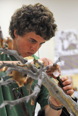 Thompson Valley High School junior Hans Gillies, 17, sculpts a human figure out of wax as he works on sculpture Tuesday during AP studio art class at the school.