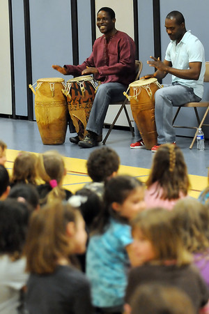 Maputo Mensah, back left, and his brother Mawuenyega Mensah play African drums during a multi-cultural assembly Wednesday in the gymnasium at Sarah Milner Elementary School.