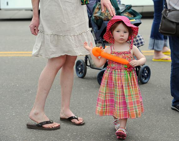 Lily Ehle, 2, walks around Wednesday during Children's Day.