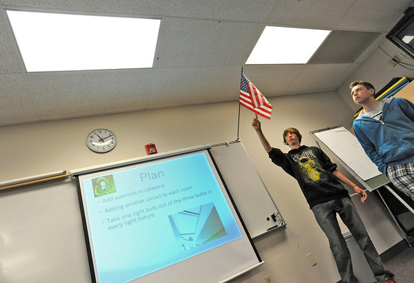 Lucille Erwin Middle School students Seth Bretches, 14, left, and Sebastian Felden, 14, right, talk about using less bulbs in the school's lighting as part of their plan to save energy during a presentation Tuesay at the school. Eighth-graders at the school presented ways to make the school more efficient.