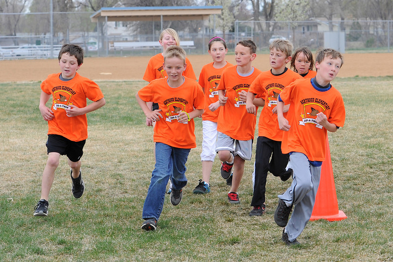 Berthoud Elementary School fourth-graders run together around the football field during the Jog-a-thon on April 11, 2012.