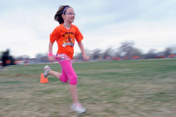 Berthoud Elementary School fourth-grader Allison Koenig runs during the Jog-a-thon outside the school on Wednesday, April 11, 2012.