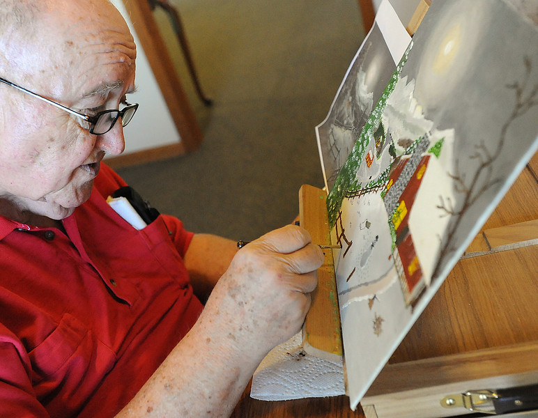 0405 NWS SeniorArtist-js.jpg Art Cole, a resident at Sterling House in Loveland, works on a painting Wednesday. Cole is a finalist in the Assisted Living Federation of America Senior Living Art Showcase.
