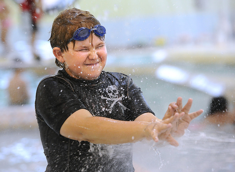 Chase Quade of Loveland, 11, gets sprayed with a huge water gun Monday at the Chilson Recreation Center. Kids participating in the recreation center's spring break day camps went swimming after going to Chuck E. Cheese and have fun acitivities planned all week long. Photo by Jenny Sparks