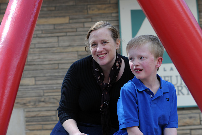Eight-year-old Liam Adams poses with his mother Amanda on Friday, April 20, 2012 outside the Loveland Museum/gallery in downtown Loveland. Liam was born with 10 different heart defects in the structure of his heart and has been in and out of hospitals since he was born.