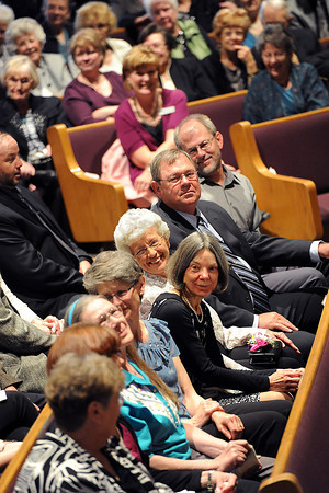 Family of Claude Stansberry, including his wife Mary, center, and children smile as others share fond memories about him Monday during a celebration of life at Faith Church in Loveland. Stansberry served as the superintendent in the Thompson School District from 1969-1980 and Stansberry Elementary Shool was named in honor of him.