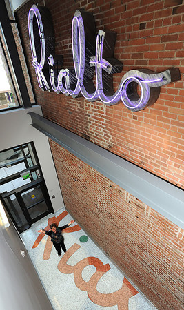 0401 NWS Rialto-js.jpg Jan Sawyer, director of the Rialto Theater Center, poses for a photo on the terrazzo floor Wednesday in downtown Loveland. Sawyer said the floor is her favoirte part of the new building. Photo by Jenny Sparks