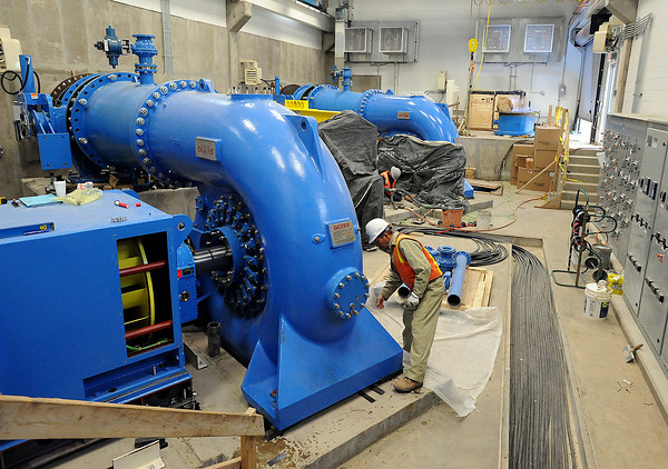 Crews work to install equipment at the first hydroelectric plant Wednesday at Carter Lake west of Loveland.