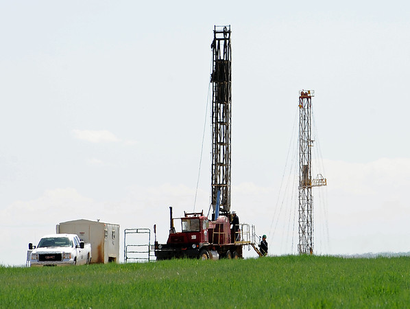 Two drilling rigs, just inside Weld County a mile east of Centerra on Monday, illustrate the encroachment of gas and oil production in the vicinity of Loveland.