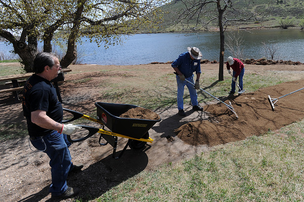 Loveland Fishing Club members volunteer their labor Thursday, April 19, 2012 at Flatiron Reservoir where improvements are being made with funds from a Fishing is Fun grant. From left are Mike Scheber, Tom Miller, and Jim Giles.