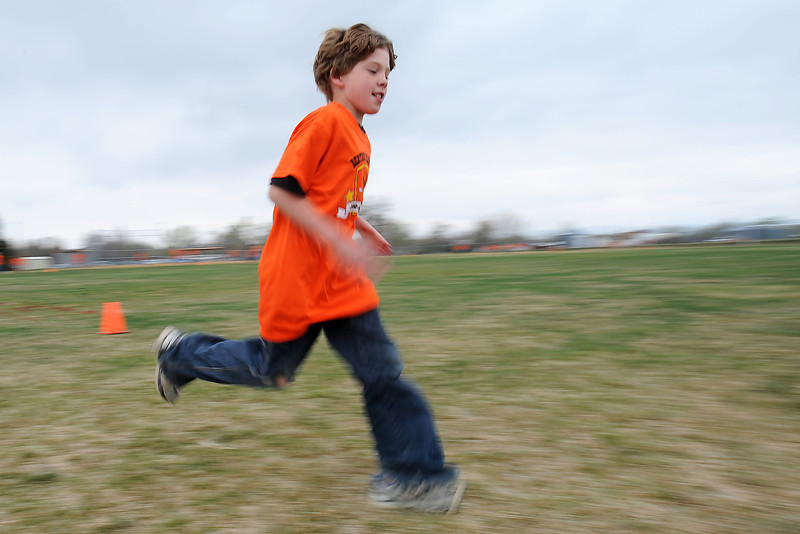Berthoud Elementary School fourth-grader Jeromiah Lewis runs during the Jog-a-thon outside the school on Wednesday, April 11, 2012.