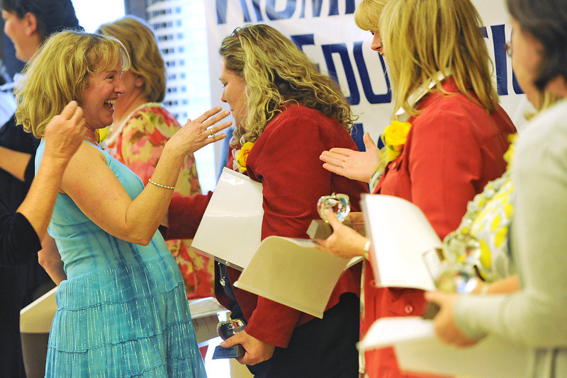 Sarah Milner Elementary School teacher Lisa Englund, left, shares a laugh with other award winners during the 11th Annual Crystal Apple Awards ceremony Friday, April 20, 2012 at the Chilson Senior Center.