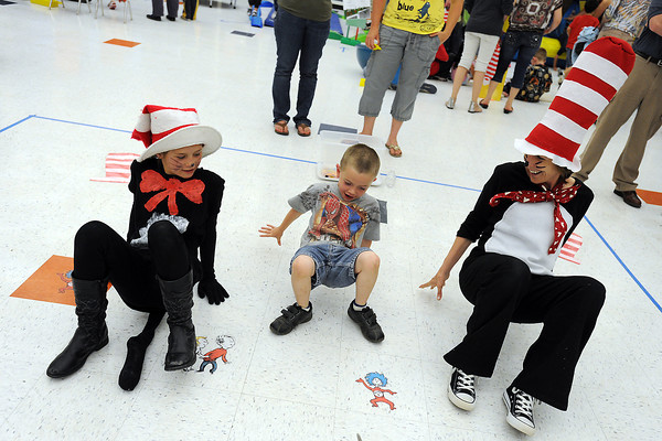 Six-year-old Thomas Dechant, middle, plays a crabwalk game with Morgan Madrid, 10, left, and teacher Jenn Brunner during the Born to be a Reader Family Literacy Carnival on Thursday, April 26, 2012 at Conrad Ball Middle School.
