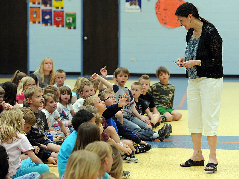 Teresa Funke, a local author, talks to Carrie Martin Elementary School first and second-graders about story writing Friday to help kick-off their two week Read-A-Thon. Photo by Jenny Sparks