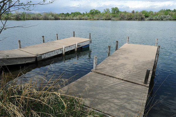 Several docks jut out into the water Thursday in the southeast pond of the Agilent Open Space in Loveland.