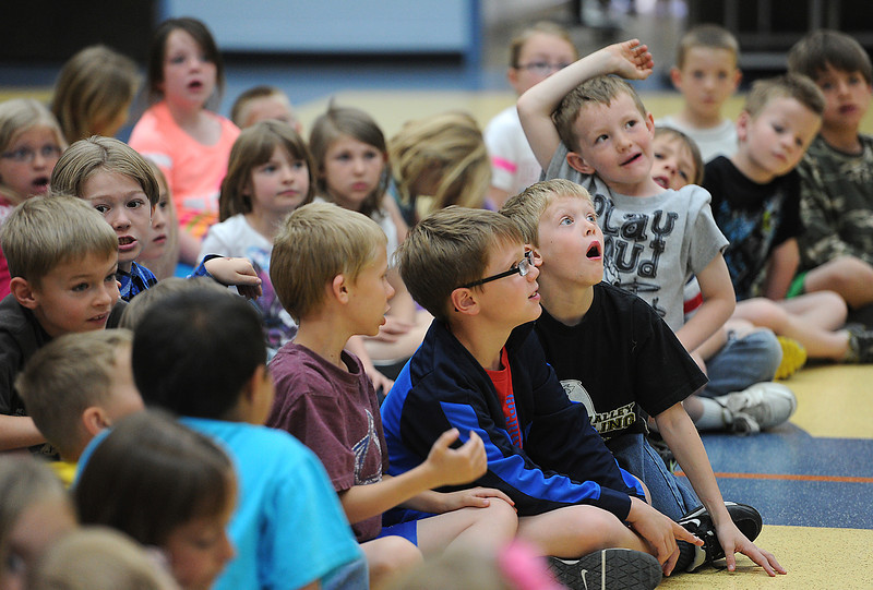 Carrie Martin Elementary School second-grader Logan McCrimmon, 8, center right, drops his jaw as local author Teresa Funke tells students she will give them her autograph Friday during a writing workshop to kick-off their two week Read-A-Thon. Photo by Jenny Sparks
