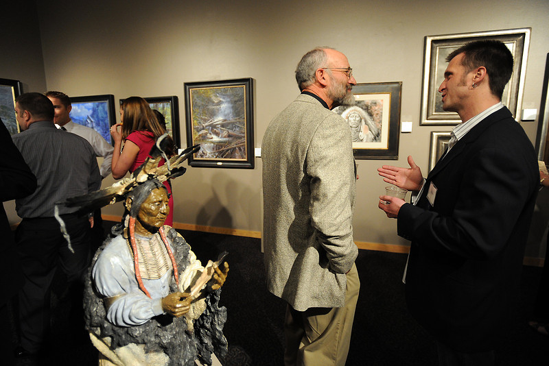 Loveland-based artist Pedro Ramos, right, chats with artist Charles Ewing of Antonito, Colo. during the Governor's Invitational Art Show and Sale at the Loveland Museum/Gallery on Saturday, April 28, 2012.