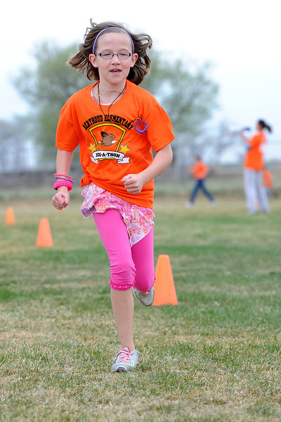 Berthoud Elementary School fourth-grader Allison Koenig runs during the Jog-a-thon outside the school on Wednesday, April 11, 2012.