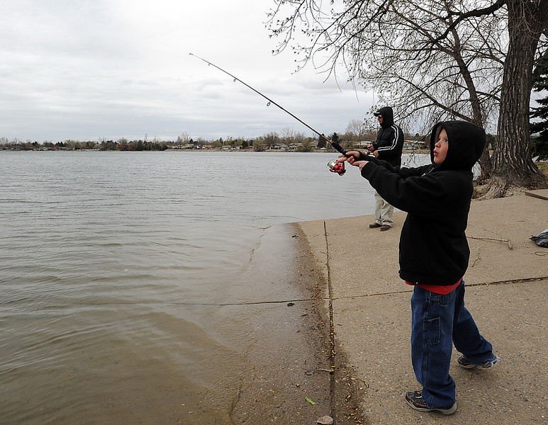 Christopher Hansen jr, 10, casts his line while fishing with his dad Chris Hansen on a chilly Monday morning at Lake Loveland. Photo by Jenny Sparks