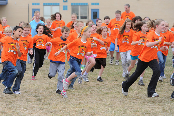 Berthoud Elementary School fourth-graders take off from the starting line outside the school on the playground during their Jog-a-thon on Wednesday morning. Participants in the fundraiser gathered pledges for each lap they completed around the football field. All grades took part in the event this week at which they also learned about the benefits of exercise and wellness.