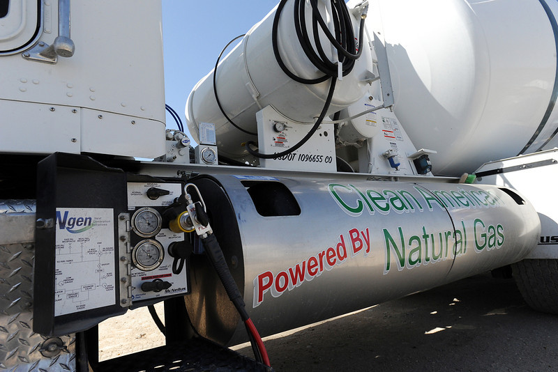 A concrete mixing truck owned by Johnstown Ready-Mix, a division of Loveland Ready-Mix, is plugged in at the firm's fueling station Thursday, March 29, 2012 to replenish the compressed natural gas that powers the truck.