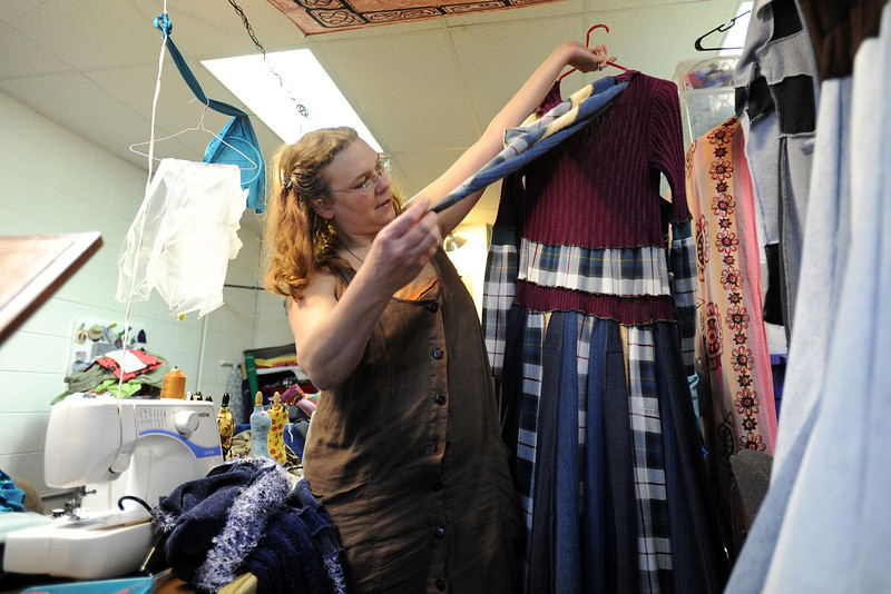 Bonnie McLeod Carmichael holds up a garment that she created out of old sweaters as she talks about how she repurposes clothing at her Rip Club Sewing shop located at 2238 W. First St. in Loveland.