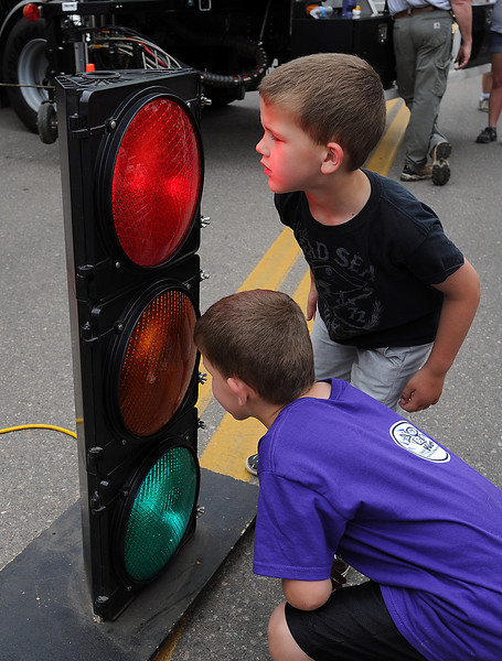 Twin brothers Lane Westman, 5, top, and Levi Westman check out a traffic signal during Children's Day.